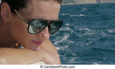 Young Smiling Woman In Sunglasses Sits On Yacht Boat