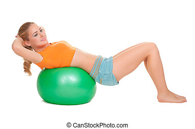 Young smiling woman on ball