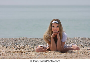young smiling woman on beach