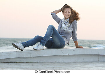 young smiling woman on sea background