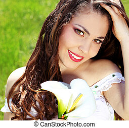 Young smiling woman outdoors portrait. Sunny colors.