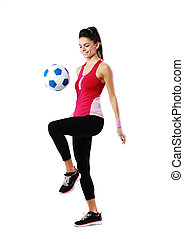 Young smiling woman playing with soccer ball over white background