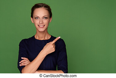 Young smiling woman pointing finger