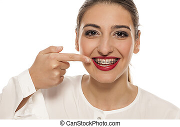 woman pointing on her braces