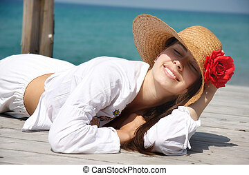 young smiling woman relaxing on sea background