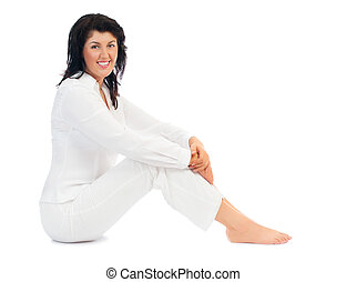 Young smiling woman sitting on floor