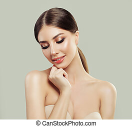 Young Smiling Woman Spa Model with Healthy Skin. Portrait