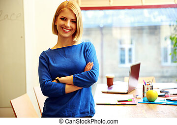 Young smiling woman standing in office