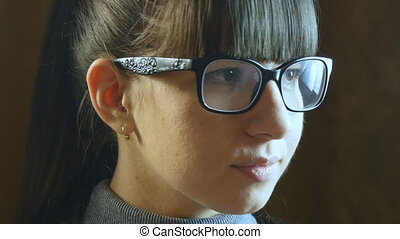 Young smiling woman wearing glasses.