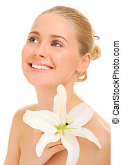 Young smiling woman with flower