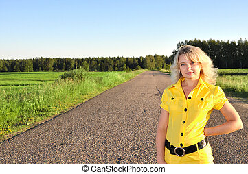 Young smiling woman with on empty road