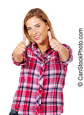 Young smiling woman with thumbs up