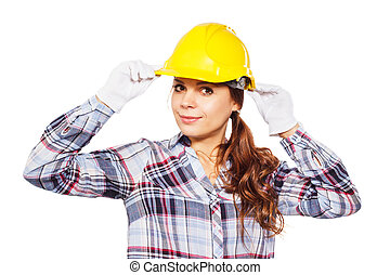 Young smiling worker in the helmet