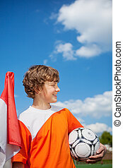 young soccer player against blue sky