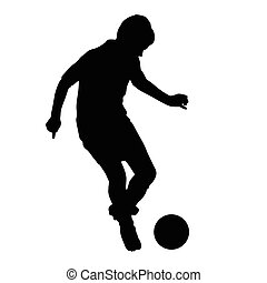 Young soccer player passes the ball silhouette, kid plays soccer or football. Front view. Football player is taking off with the ball