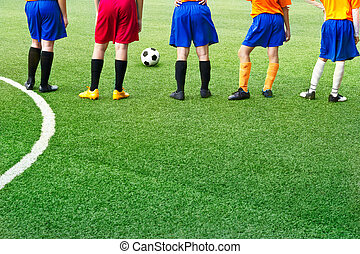 Young soccer players in field soccer academy