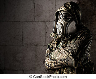 young soldier - portrait of soldier with gas mask leaning...