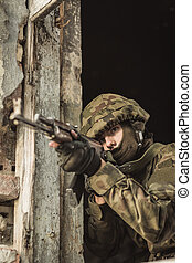 Young soldier with pistol