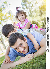 Young Son and Daughter Having Fun With Their Dad Outdoors