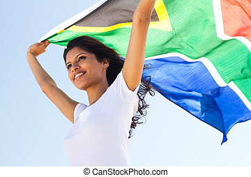 young south african patriot on the beach