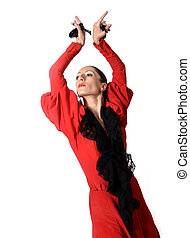 young Spanish woman dancing flamenco with castanets in her...