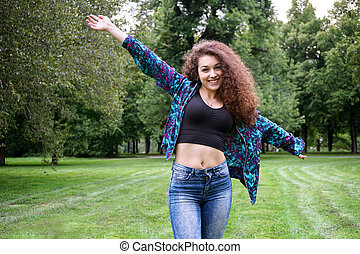 young spanish woman enjoying nature in a park...