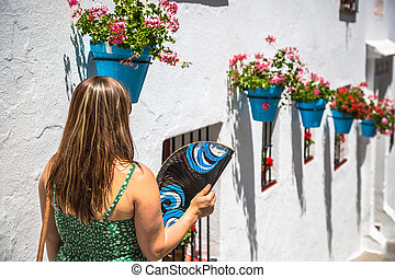 Young spanish woman with fan.