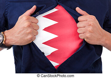 Young sport fan opening his shirt and showing the flag his country Bahrain, Bahraini flag