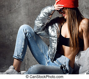 Young sport woman after workout exercise posing in silver...