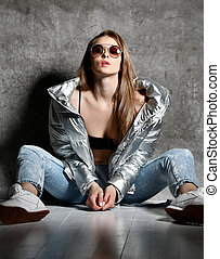 sport woman after workout exercise posing in silver shiny...