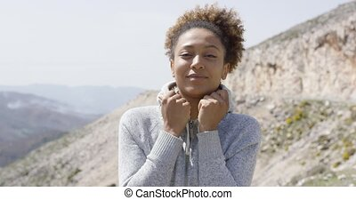 Young sportive woman looking at camera