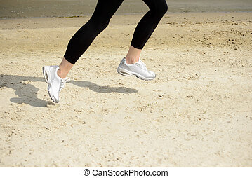 Young Sports Woman Running on the Beach