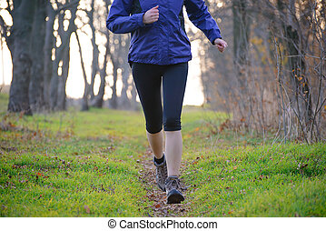 Young Sports Woman Running on the Forest Trail in the Morning
