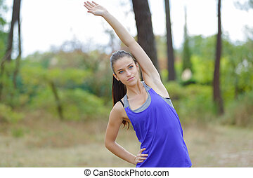 young sports woman stretching arms
