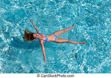 Young sports woman swims