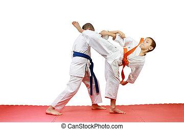 Young sportsmen in karategi