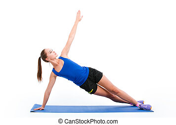 Young sportswoman in sportwear doing yoga - Young beautiful...