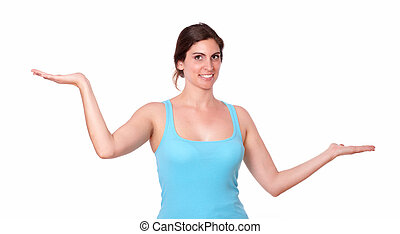 Young sporty female holding palms out