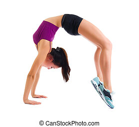 Young sporty girl does gymnastic exercises