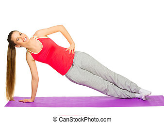 Young sporty girl doing gymnastic exercises