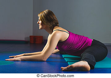 Young Sporty Girl doing gymnastic exercises in fitness class