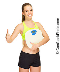 Young sporty girl with home scales