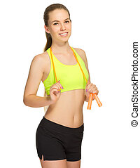 Young sporty girl with skipping rope