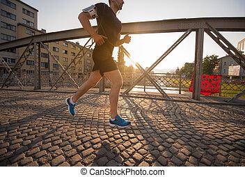 man jogging across the bridge at sunny morning