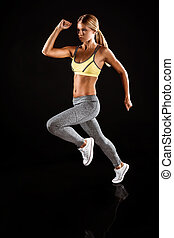 Young sporty well formed woman
