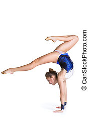 young sporty woman doing acrobatic exercise on white...