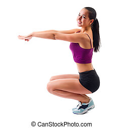 Young sporty woman doing gymnastic exercises