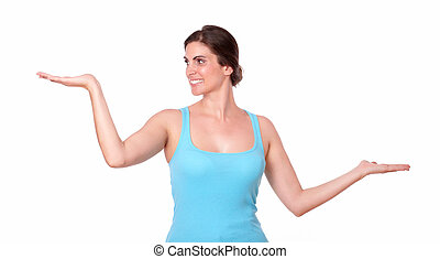 Young sporty woman holding palms out