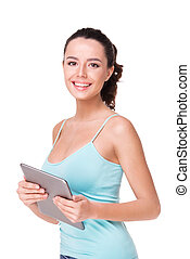 Young sporty woman holding tablet computer