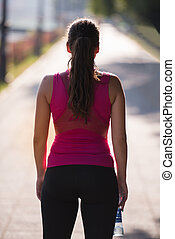 woman jogging at sunny morning